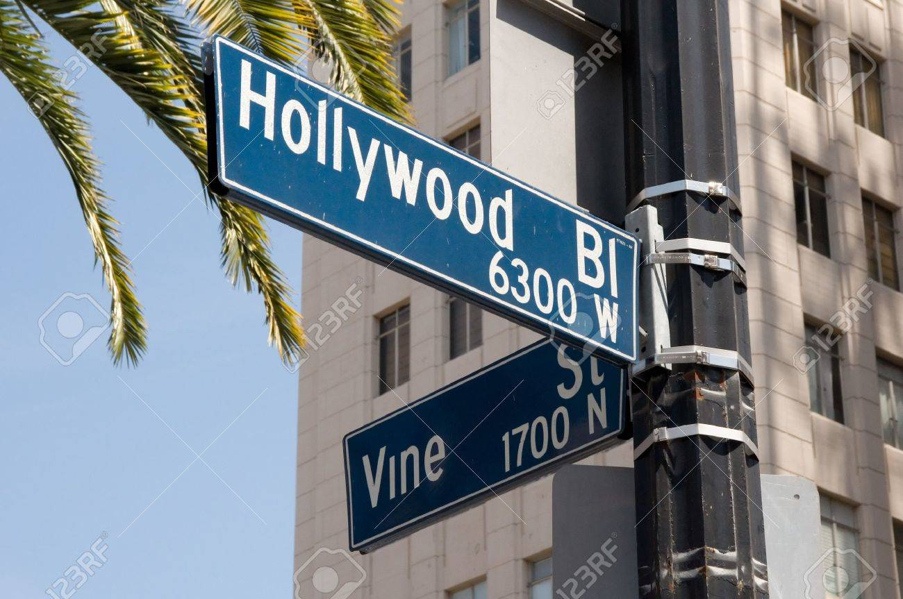 Street sign marking the famous intersection of Hollywood and Vine Streets in Los Angeles, California - 19381481