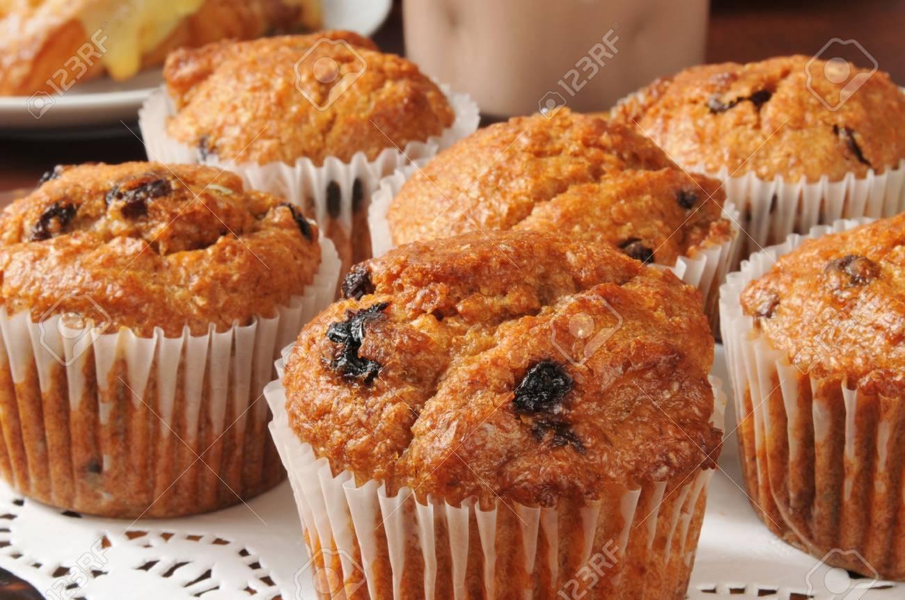Closeup of bran muffins with raisins - 19935111