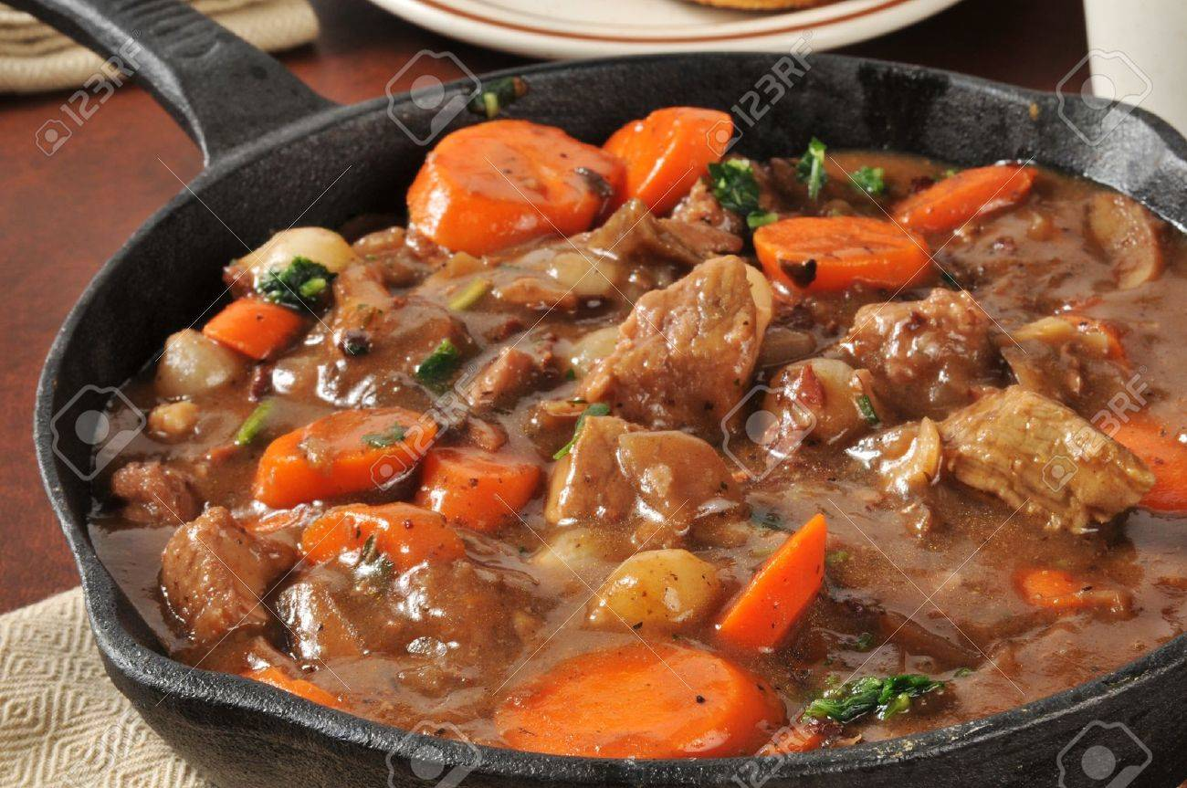 A Skillet Of Beef Stew With Carrots Pearl Onions And Mushrooms Stock Photo Picture And Royalty Free Image Image 20239708