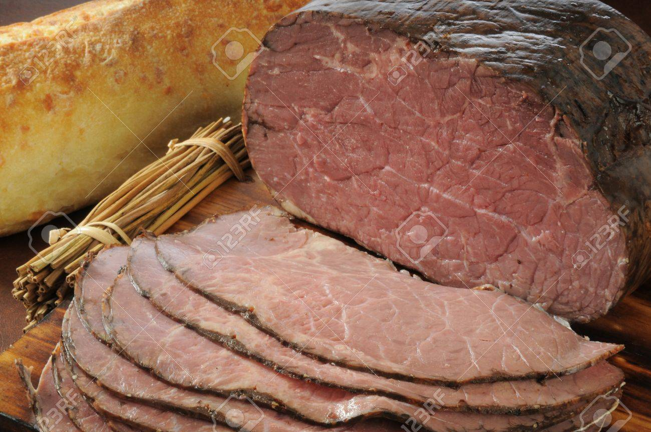 Sliced roast beef package - Stock Photo Thin Sliced Roast Beef And A Loaf Of Brad