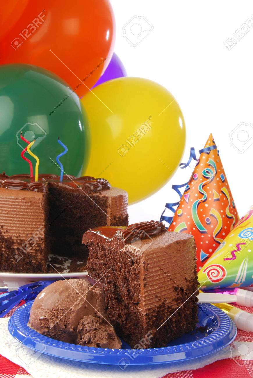 Chocolate Birthday Cake With Ice Cream Balloons And Party Favors Stock Photo