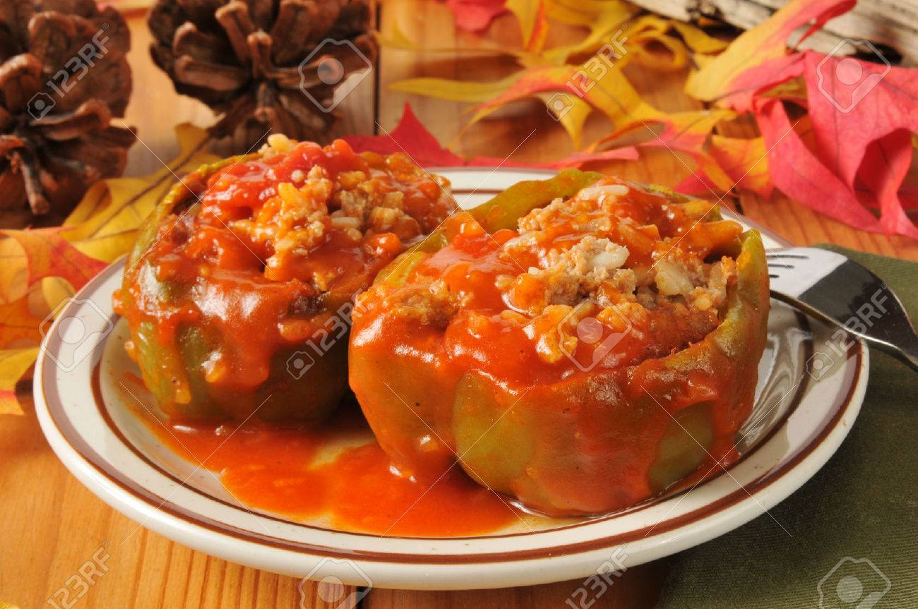 Green bell peppers stuffed with sausage, rice and tomato sauce - 24323696