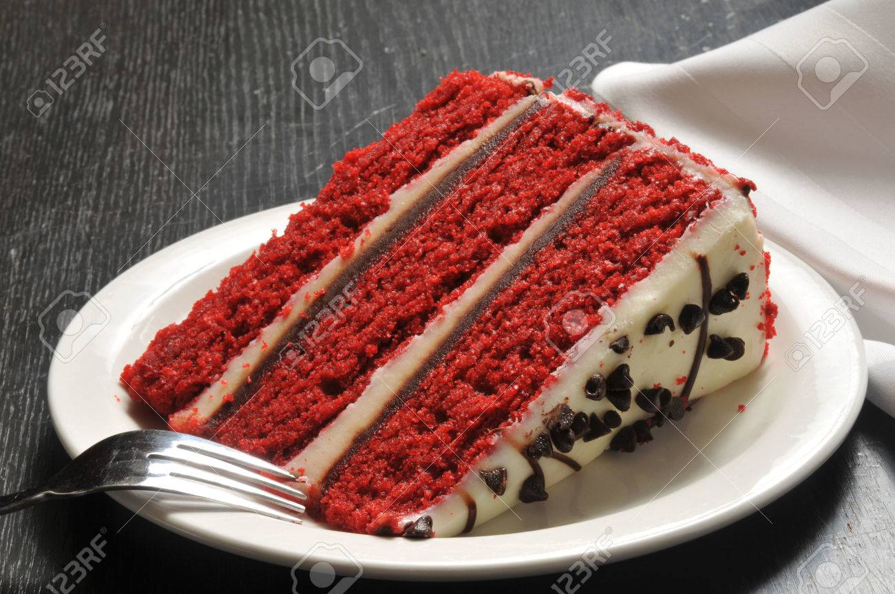 Red Velvet Cake With Frosting And Chocolate Chips Stock Photo ...