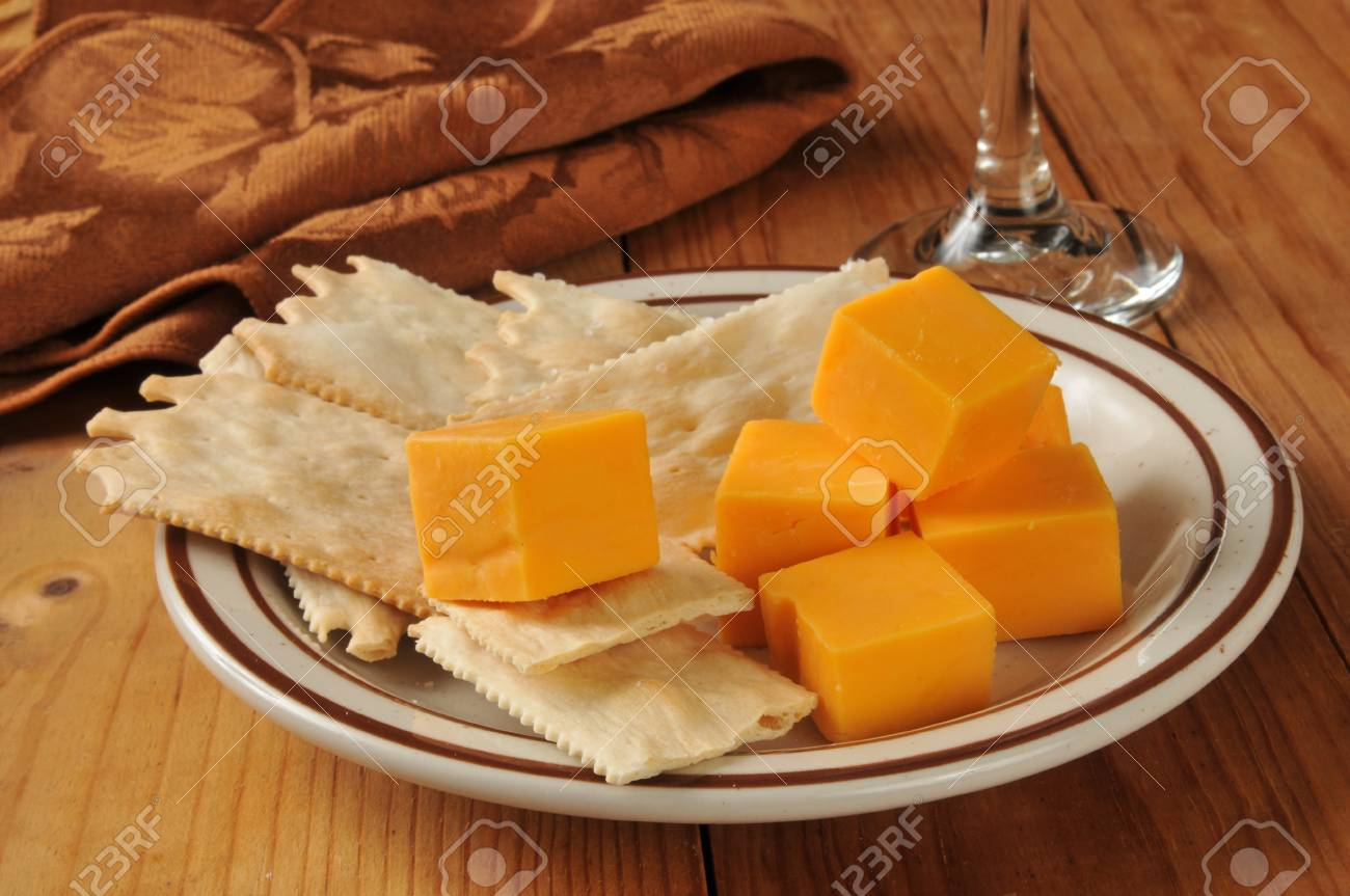 Aged cheddar cheese cubes with gourmet flatbread crackers