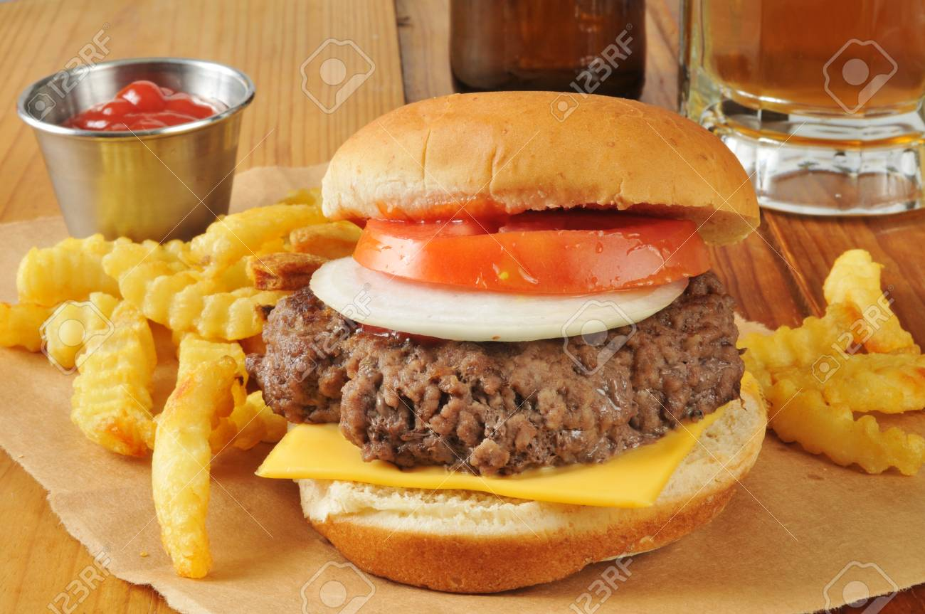 A Cheese Burger And French Fries With A Mug Of Beer Stock Photo Picture And Royalty Free Image Image 29610740