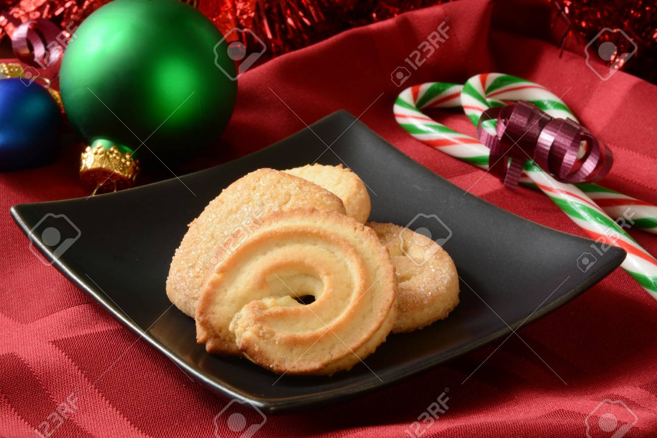 A Plate Of Butter Cookies With Candy Canes On A Christmas Table