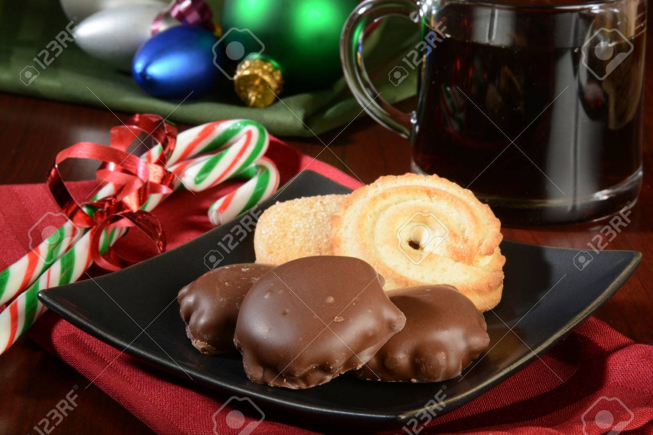 Chocolates Butter Cookies And Candy Canes With Coffee For Christmas