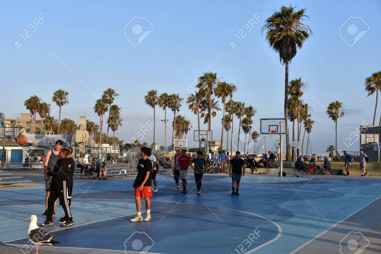 VENICE, CA/USA - July 5, 2019: People playing basketball at the Venice Beach basketball courts - 136575760