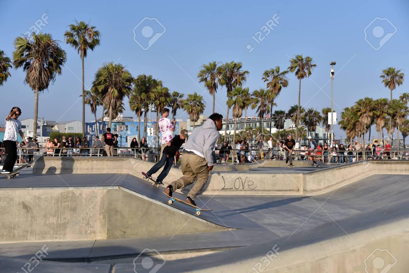 VENICE, CA/USA - July 5, 2019: Skateboarders at the famous Venice Beach Skate Park - 136576044