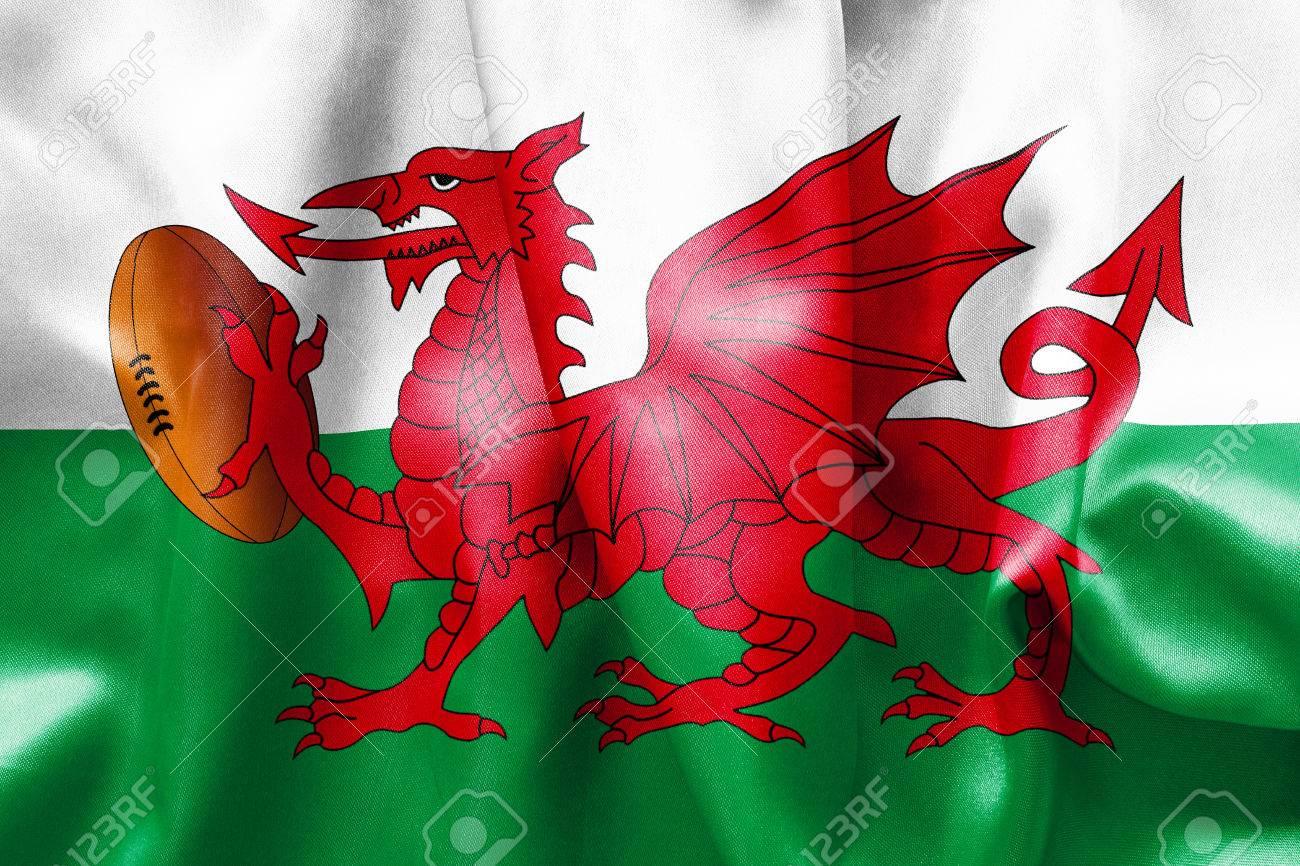 banque dimages gallois texture de drapeau avec un dragon tenant un ballon de rugby