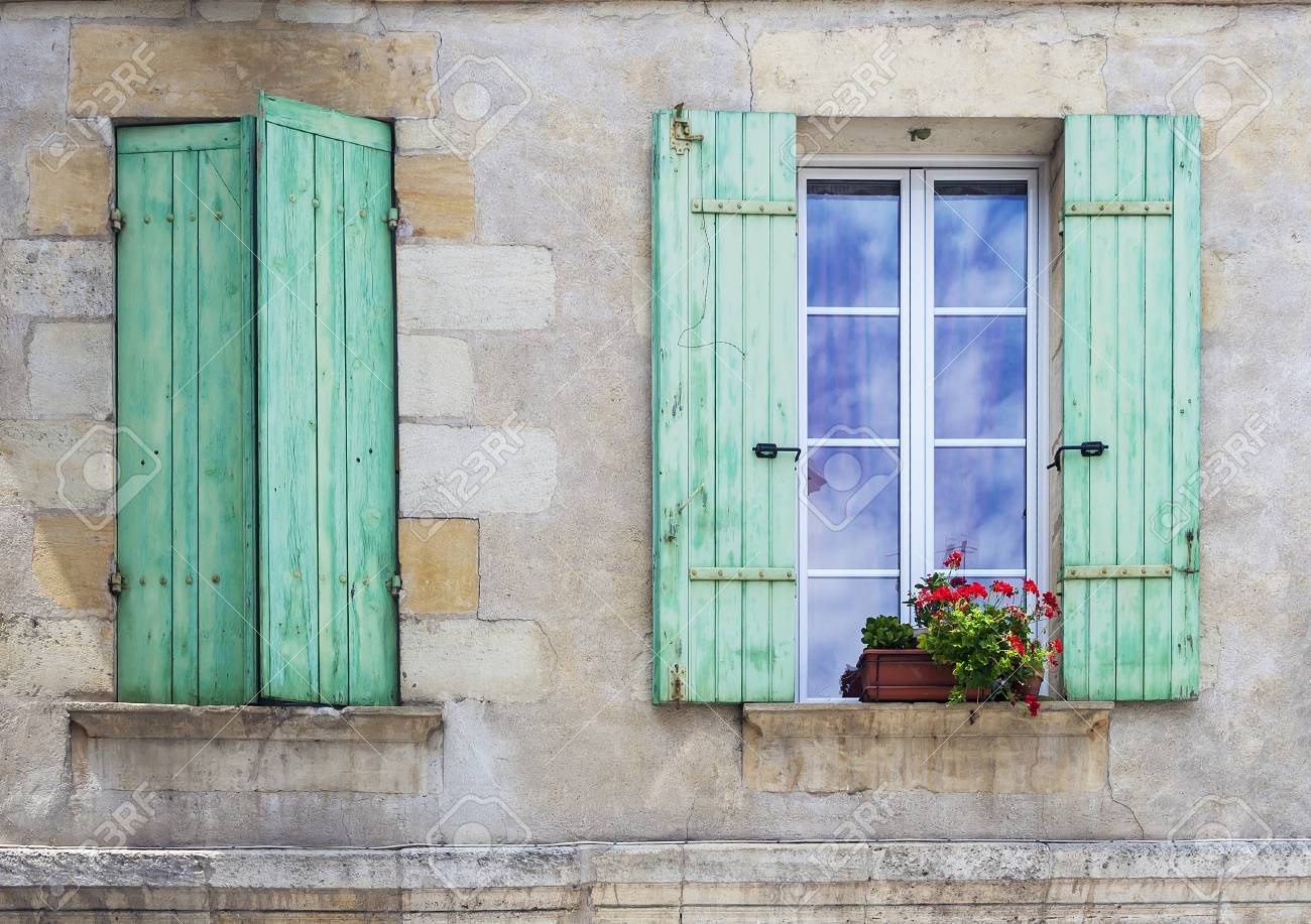 Rustic French Window Shutters With On Open And One Closed With