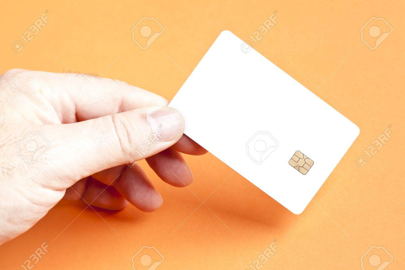 A man holding a blank smart card Stock Photo - 8328715