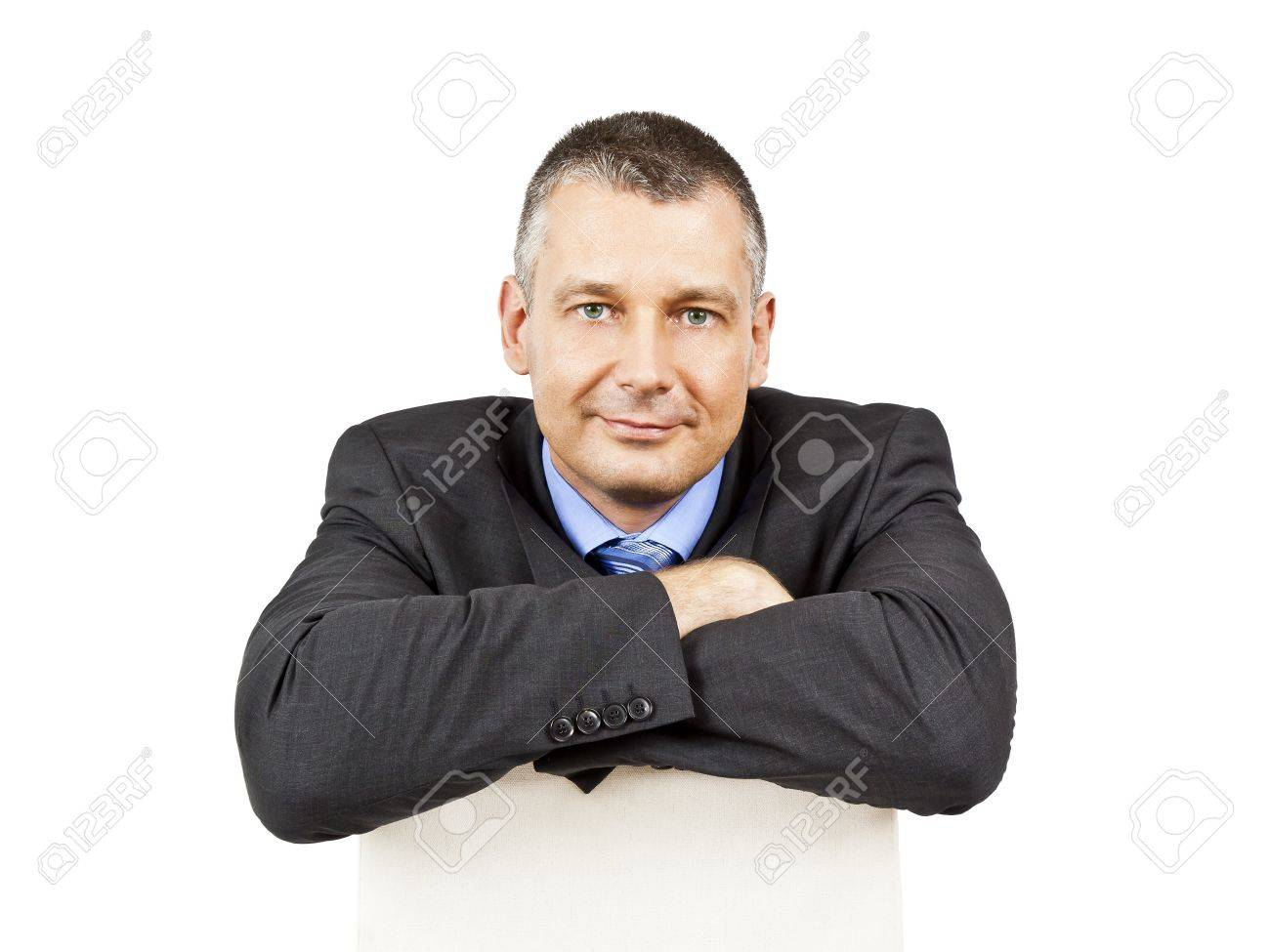 An image of a sitting business man smiling Stock Photo - 9874869