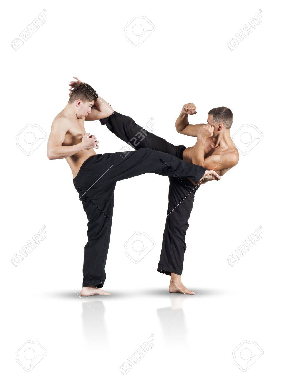 An image of two fighting men isolated on white background Stock Photo - 10421386