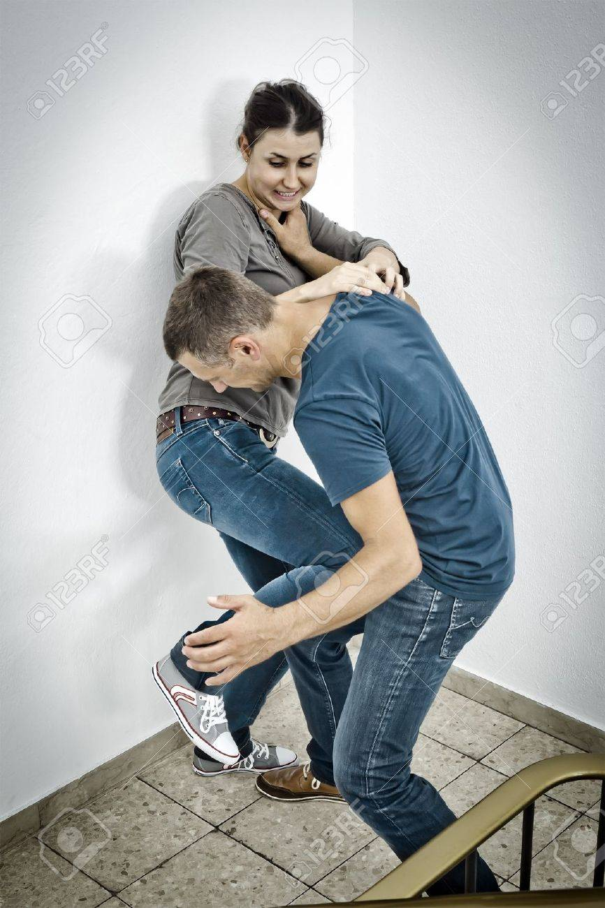 A young woman defends herself against an male attacker Stock Photo - 12397682