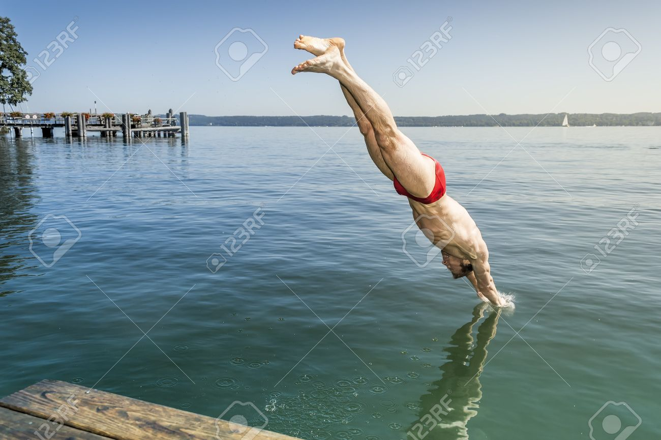 An image of a man jumping into the water