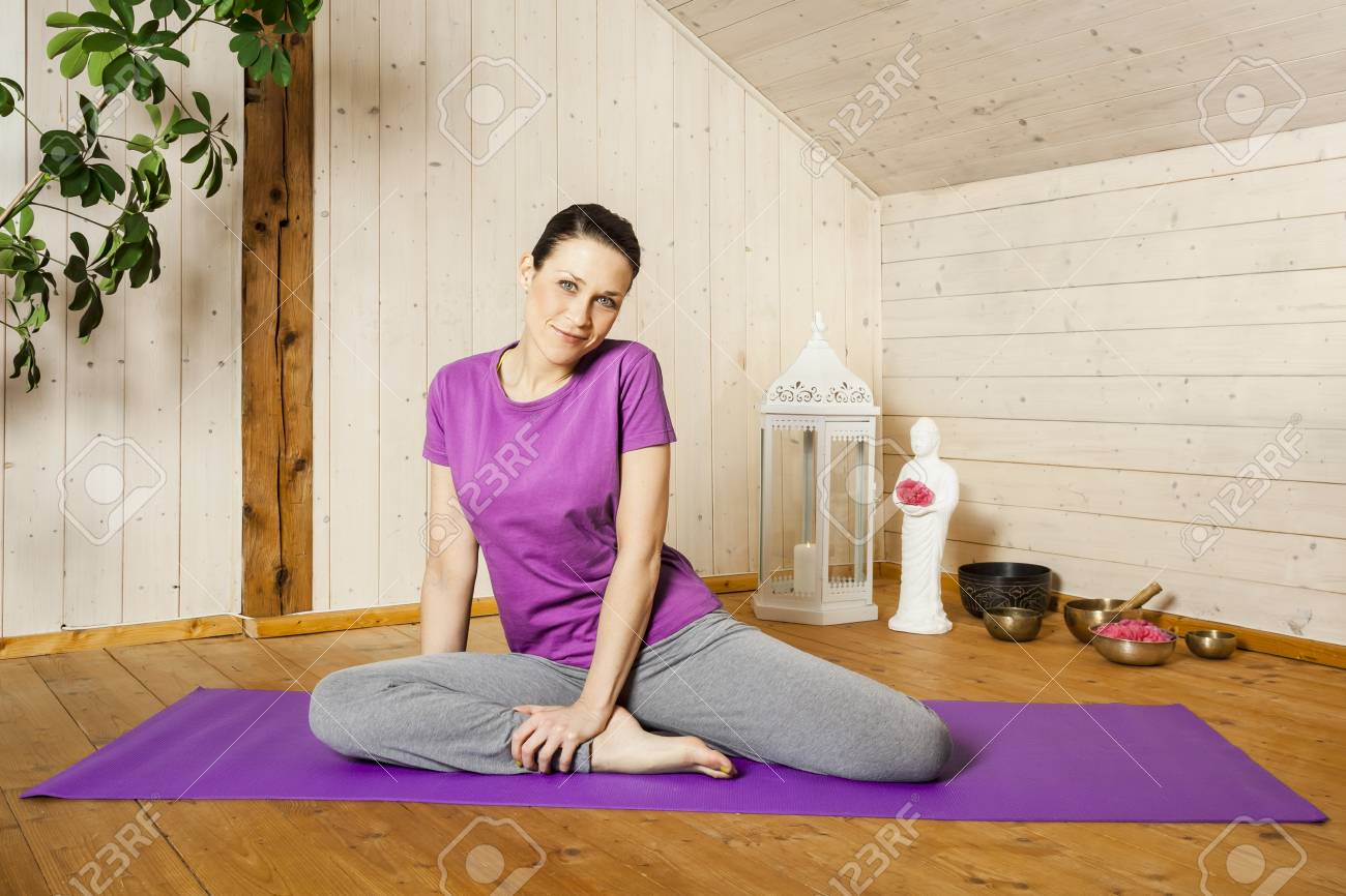 An image of a pretty woman doing yoga at home Stock Photo - 18057706