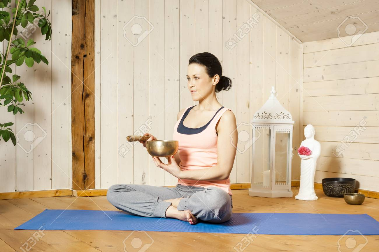 An image of a pretty woman doing yoga at home Stock Photo - 18708445