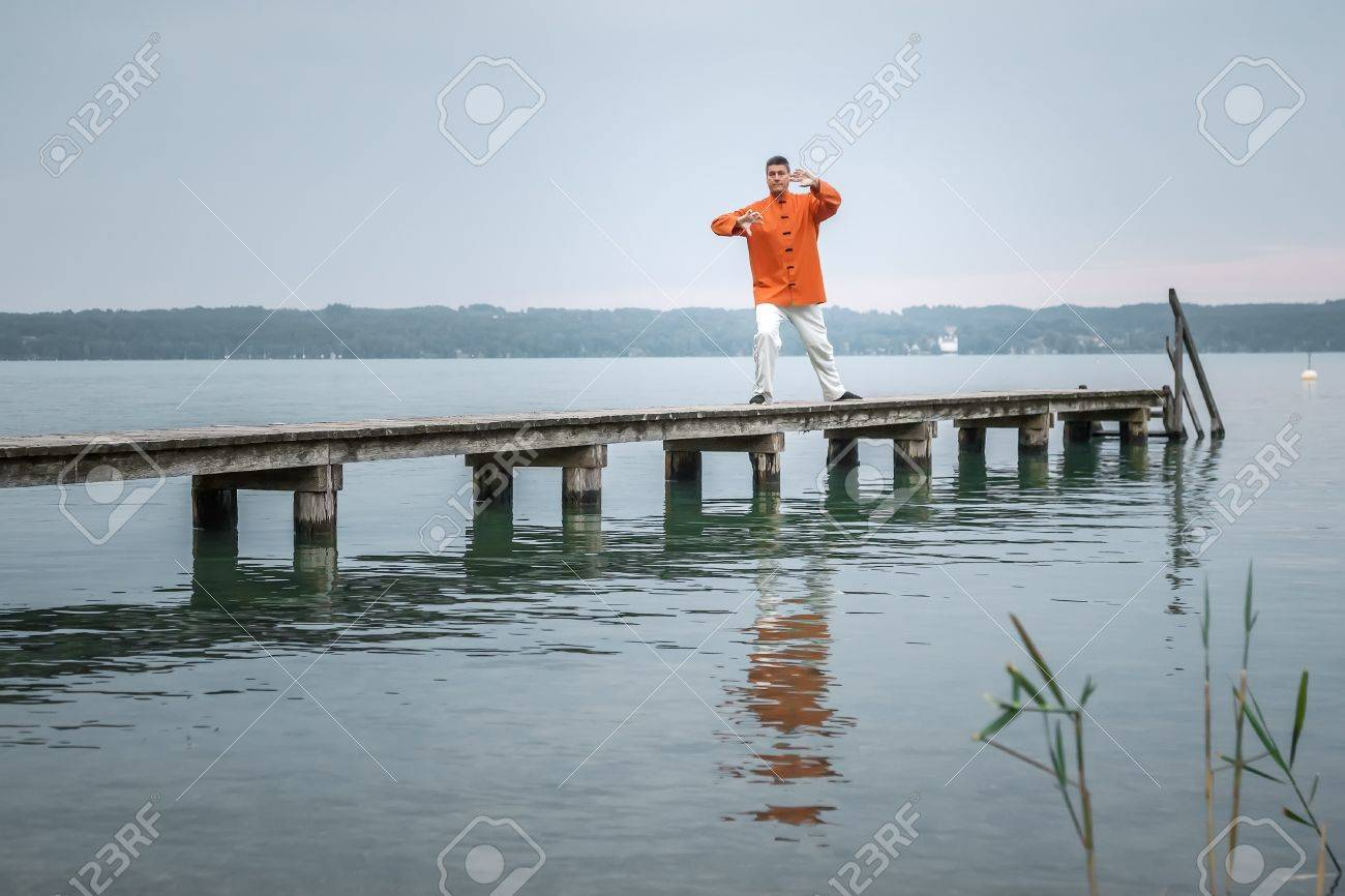 A man doing Qi-Gong in the early morning at the lake Starnberg Stock Photo - 21054159