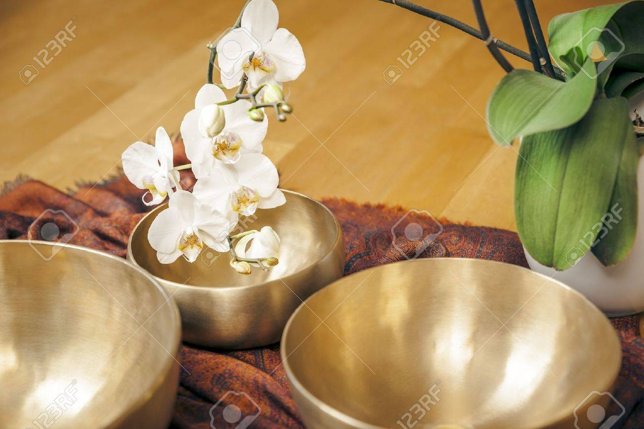 An image of some singing bowls and a white orchid Stock Photo - 21738606