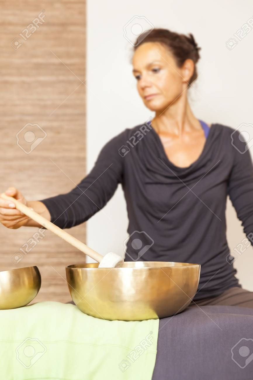 A woman is relaxing with singing bowls on her body Stock Photo - 21851263