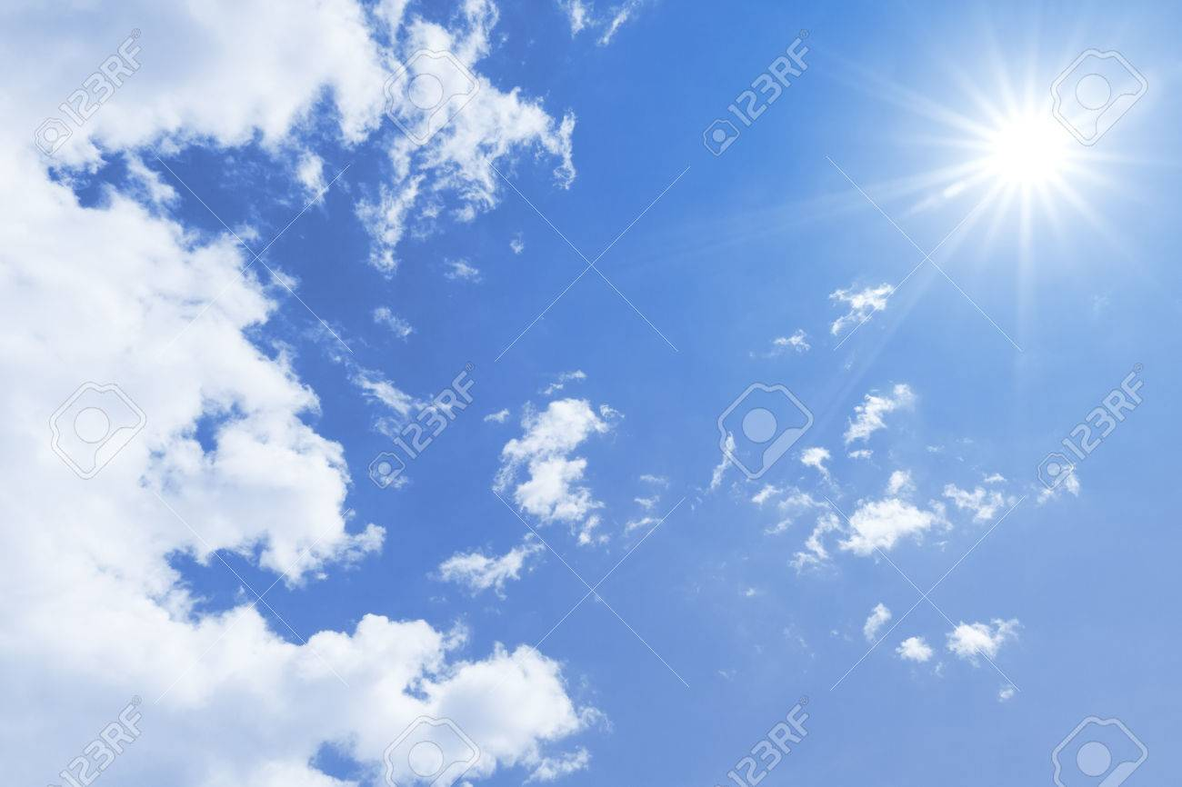 a blue sky with sun and clouds background stock photo picture and
