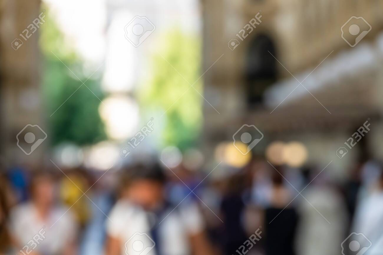 An image of walking people blurred background - 123413118