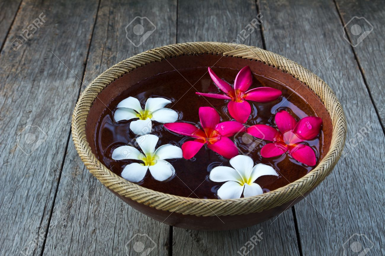 Plumeria Flower Floating In The Ancient Bowl Stock Photo Picture