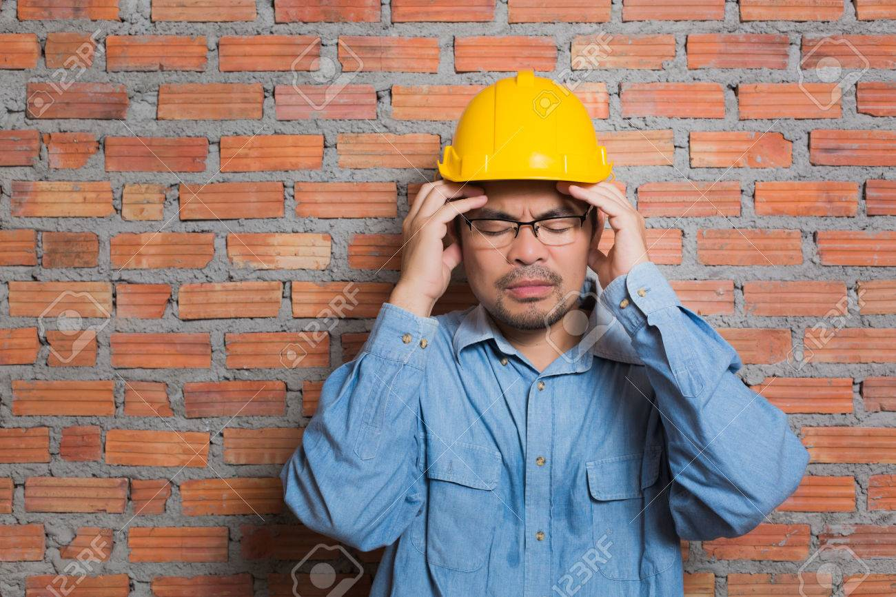 asian construction technician in stress posting stock photo 47226477