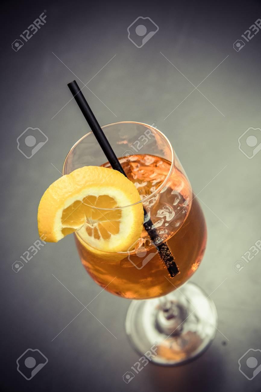 cocktail aperol spritz with straw and orange slice Standard-Bild - 61502320