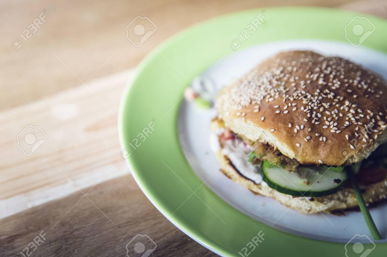 homemade veggie burger with cucumber, falafel, garbanzo, chickpea, tomato and wild celery Standard-Bild - 61502324