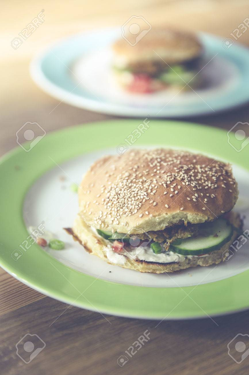 homemade veggie burger with cucumber, falafel, garbanzo, chickpea, tomato and wild celery Standard-Bild - 61502353