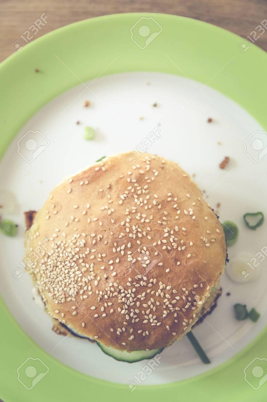 homemade veggie burger with cucumber, falafel, garbanzo, chickpea, tomato and wild celery Standard-Bild - 61502396