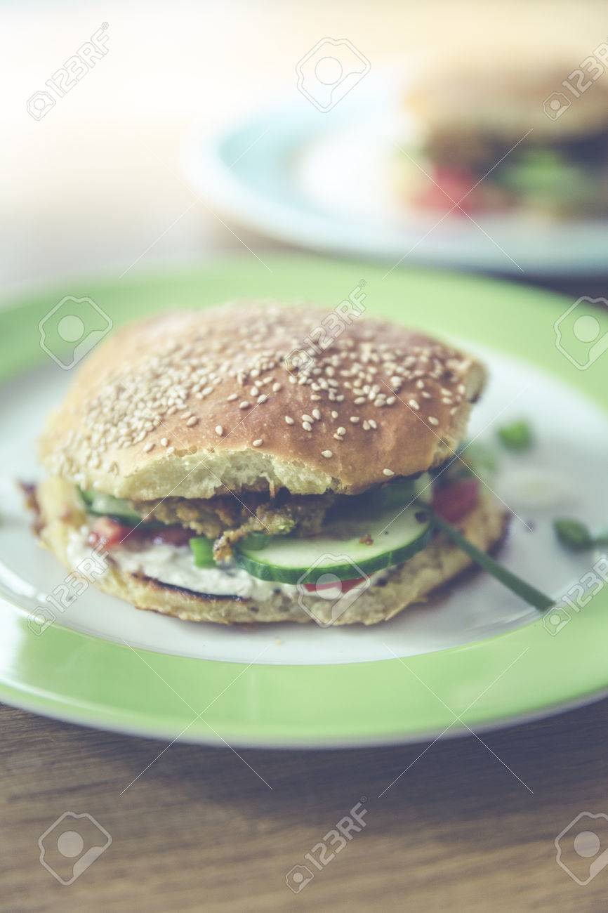homemade veggie burger with cucumber, falafel, garbanzo, chickpea, tomato and wild celery Standard-Bild - 61502403