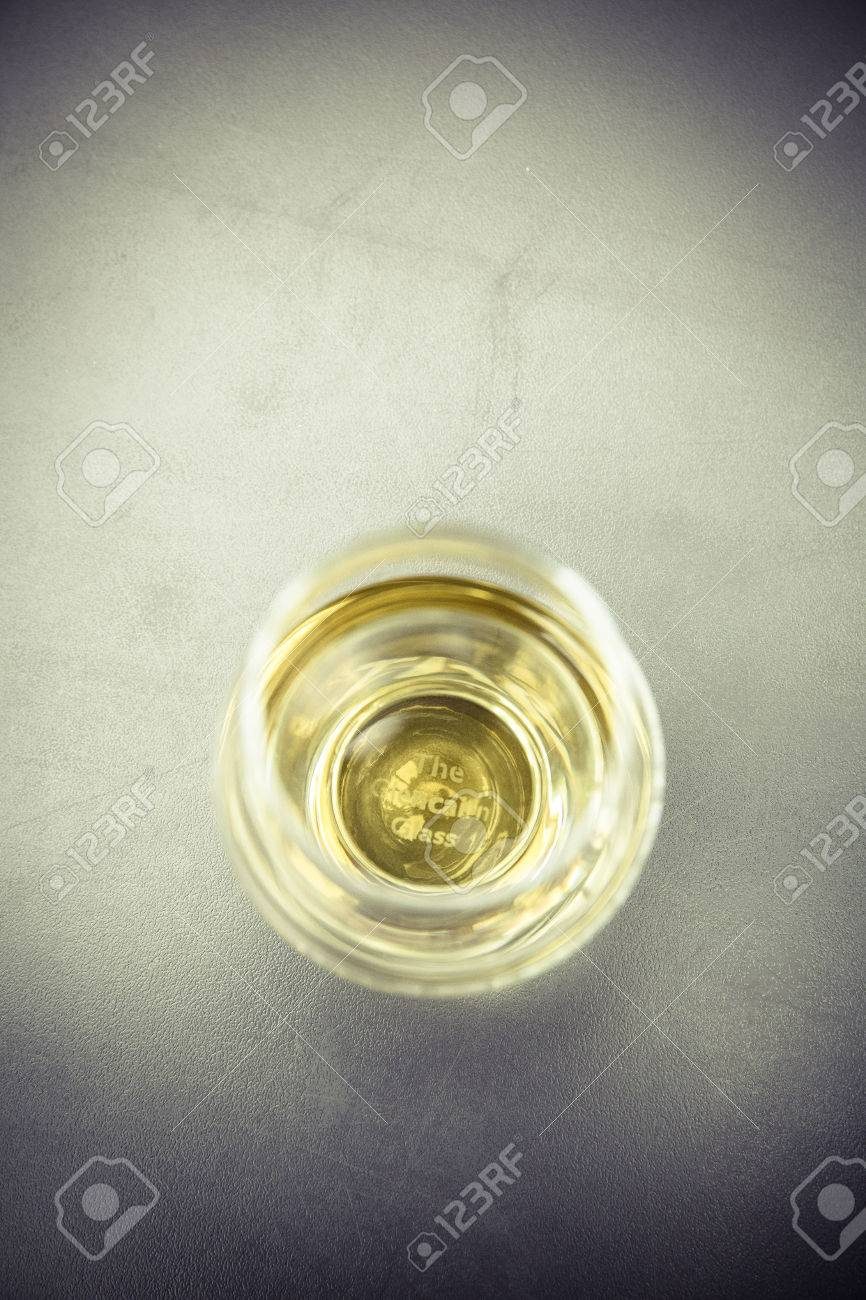 golden whiskey glass without ice cube Standard-Bild - 61502405