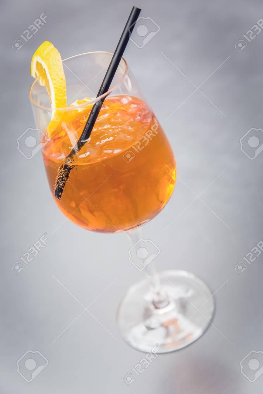 cocktail aperol spritz with straw and orange slice Standard-Bild - 61502410
