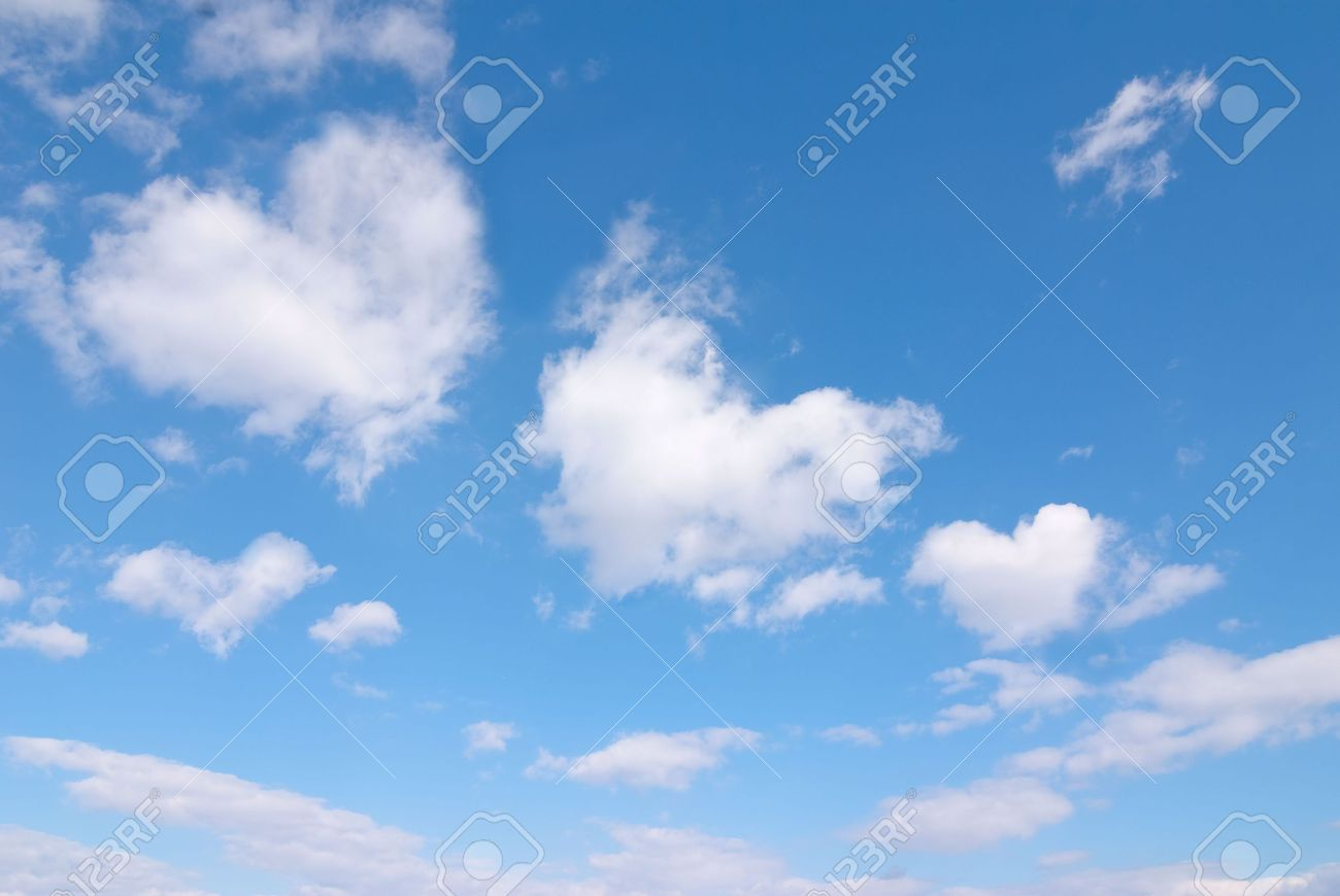 Beautiful blue sky with some romantic heart shaped clouds. Stock Photo - 6688884