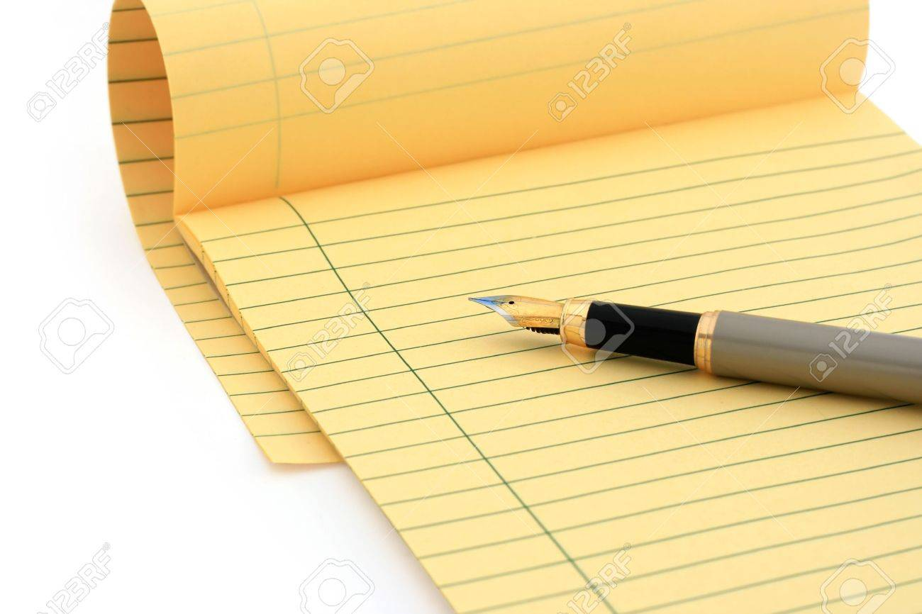 Legal pad and fountain pen on white (clipping path included)