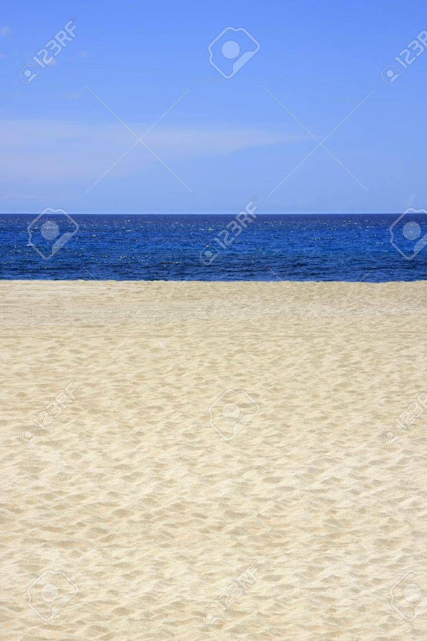 Sandy beach with blue sea and sky in vertical format Stock Photo - 11011751
