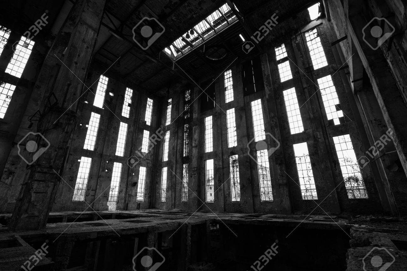 A desolate old industrial building inside black and white stock photo 29937977