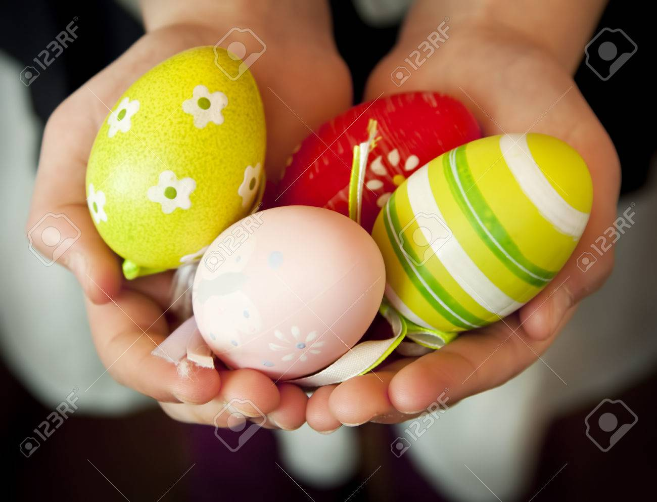 Child hands holding colorful easter eggs protection hands symbol child hands holding colorful easter eggs protection hands symbol stock photo 26600044 biocorpaavc