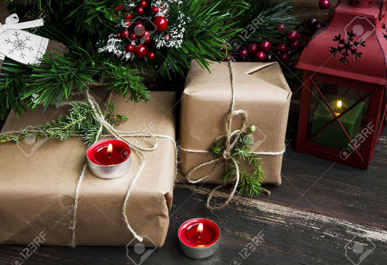 Retro Christmas Gifts Under The Christmas Tree With Red Burning ...