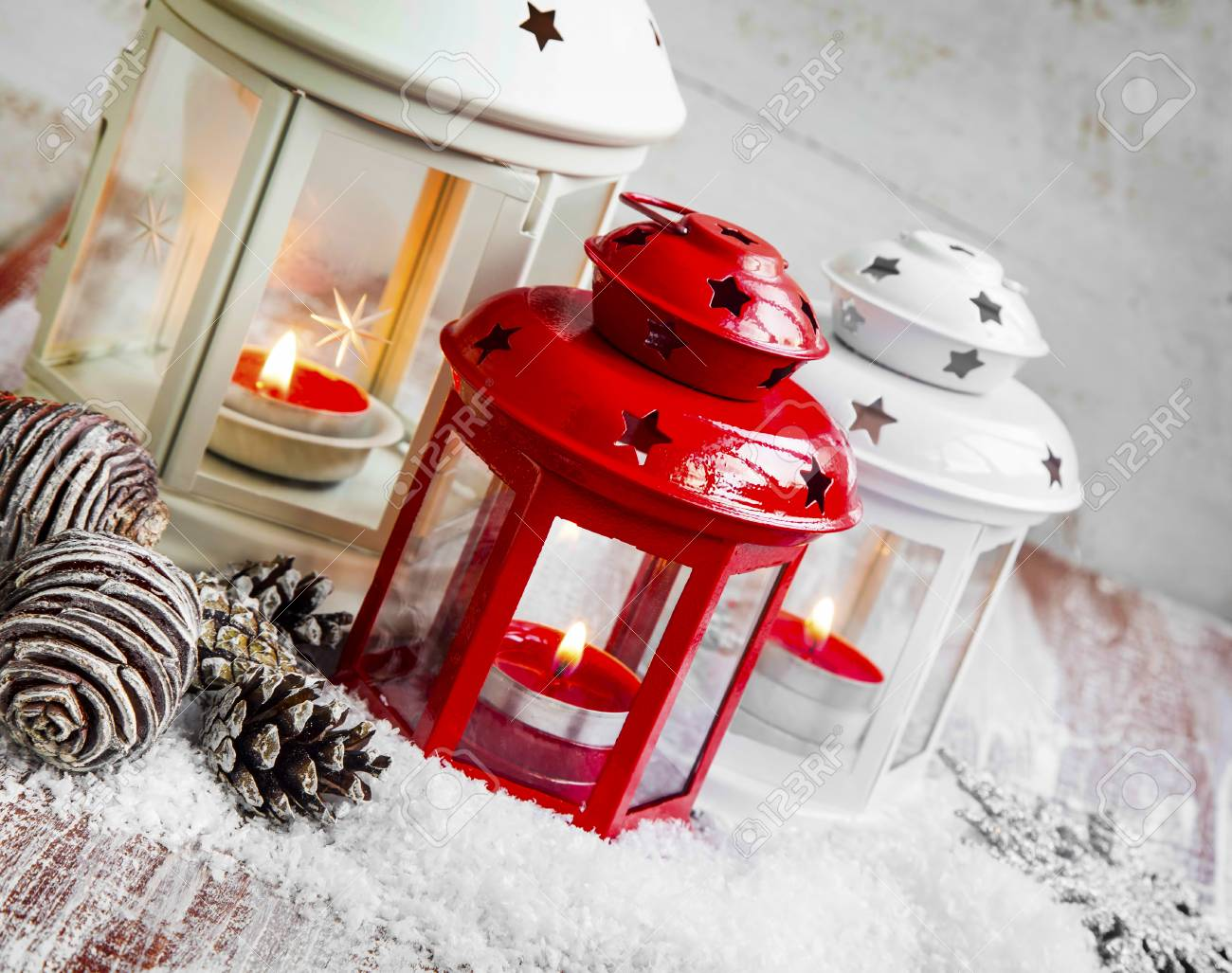 Christmas Lanterns.Christmas Lanterns With Burning Candles And Ornaments In The