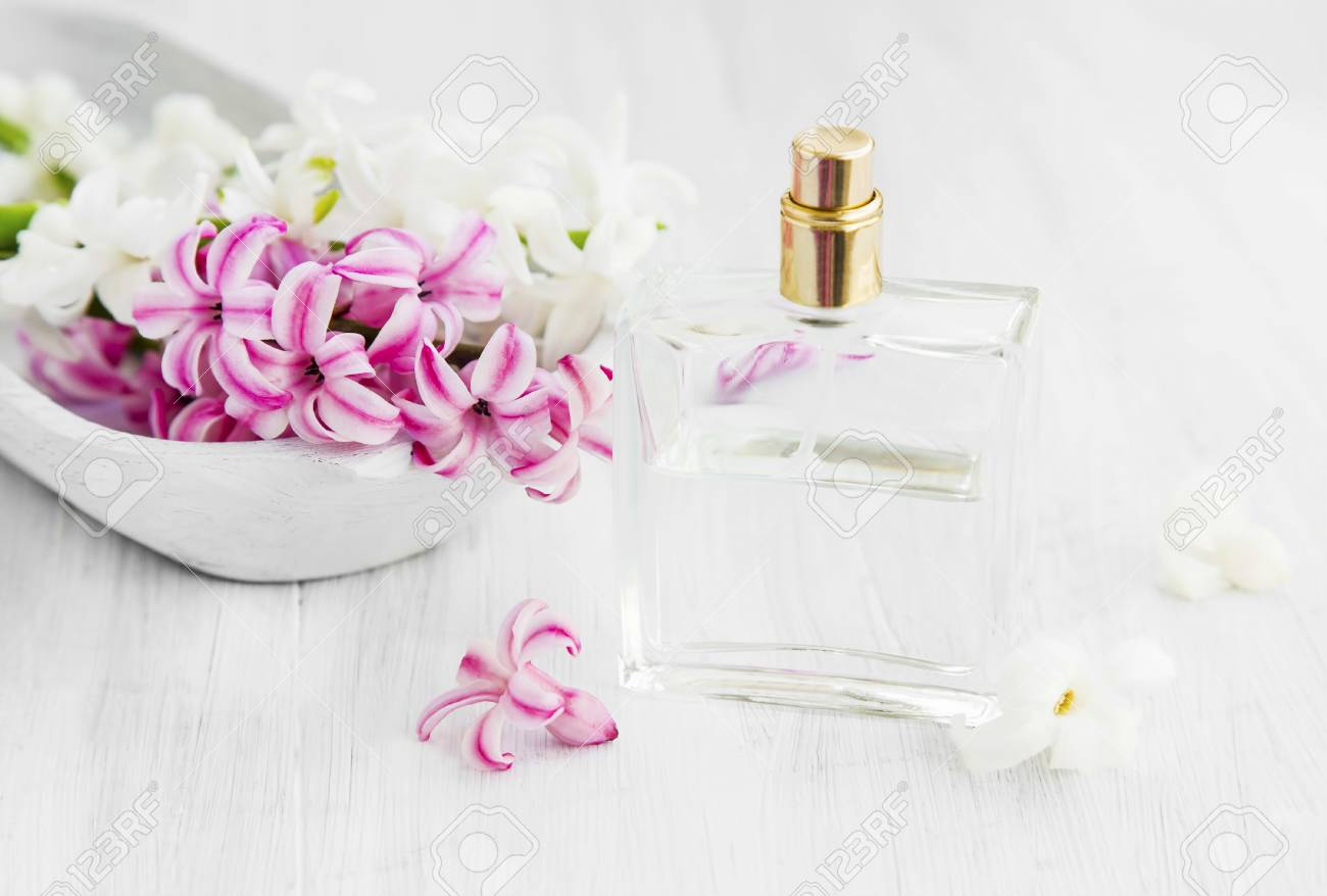 White And Pink Hyacinth Flowers With Perfume Bottlespring Flowers