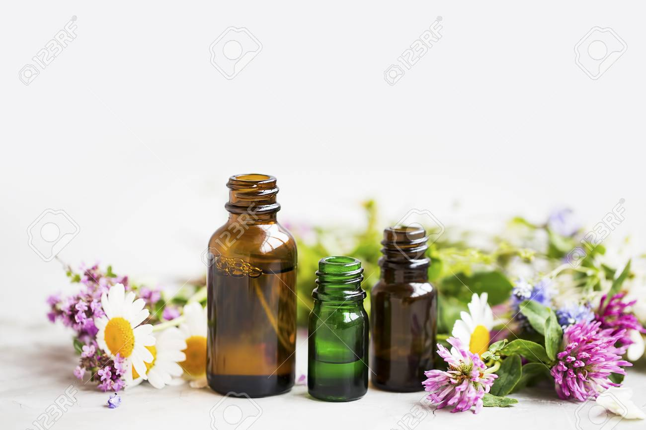 Flowers and herbs essential oil bottles, natural aromatherapy with oils and essences - 106132291