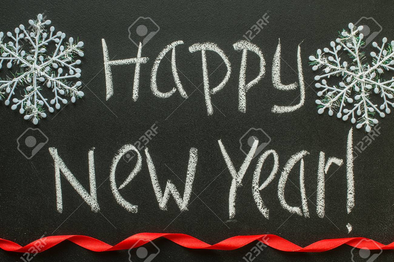 Happy new year message greeting handwriting on a blackboard stock happy new year message greeting handwriting on a blackboard stock photo 66983554 m4hsunfo