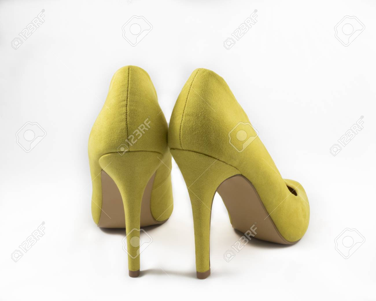c1f1bfbe00e8 Pair of Yellow High Heel Shoes on White Background Stock Photo - 44632390