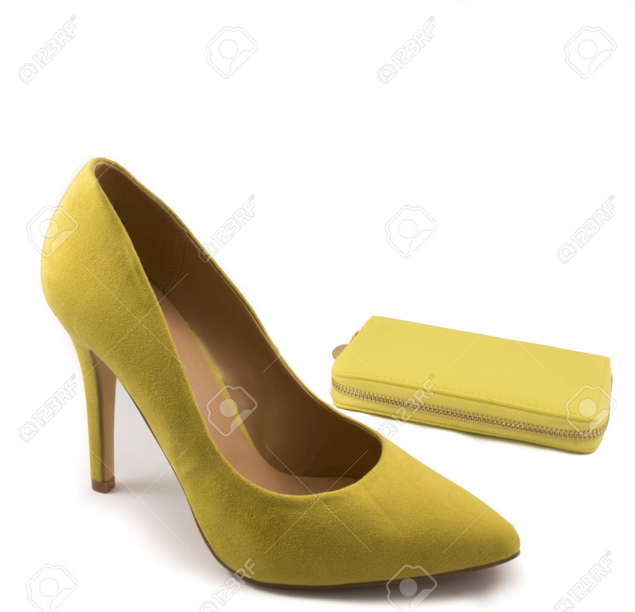 dfac6d62f040 Yellow High Heel Shoe and Yellow Purse on White Background Stock Photo -  44632393