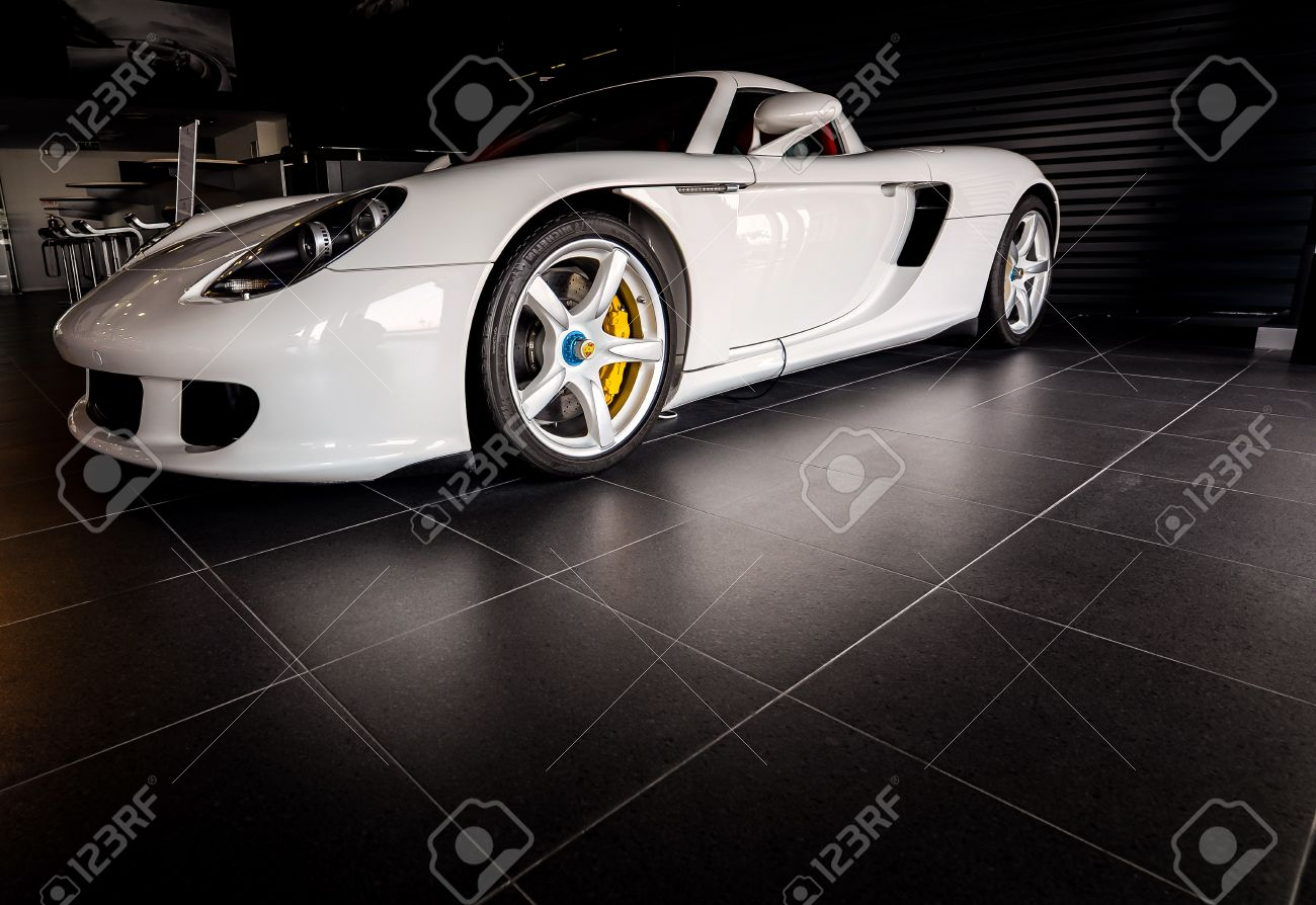 DUBAI, UAE - APRIL 15: White Porsche Carrera GT Stock Photo, Picture on porsche mirage, porsche gt3rs, porsche truck, porsche cayman, porsche gt 2, porsche concept, porsche sport, porsche gt3, porsche 904 gts, porsche turbo, porsche boxter, porsche ruf ctr, porsche cayenne, porsche boxster, porsche gtr3, porsche macan,
