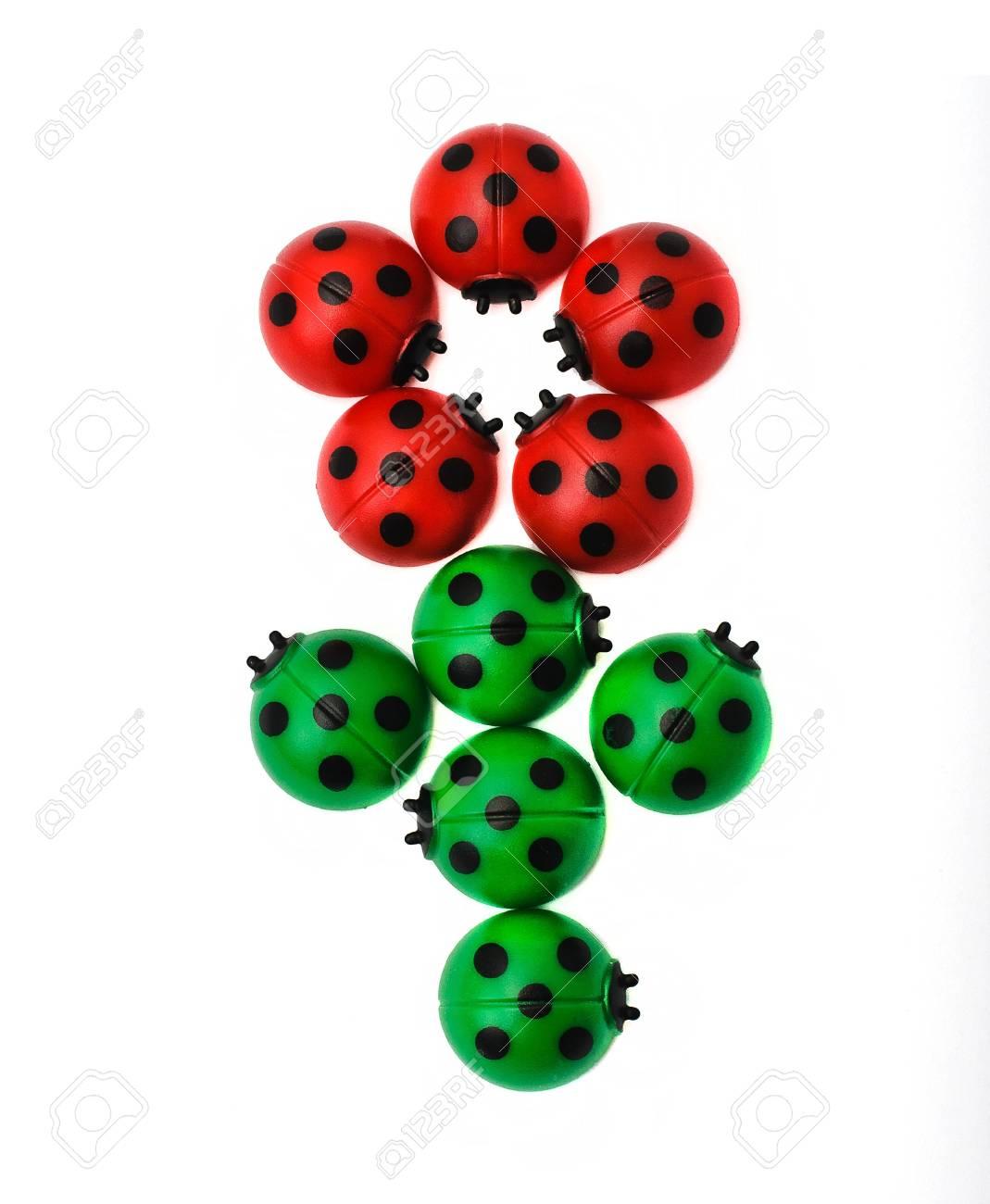 Flower from ladybugs, isolated on white background Stock Photo - 11588727